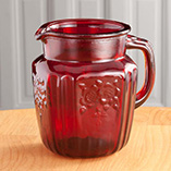 Red Glass Pitcher and Juice Glasses
